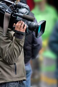 Camera man using a hook and loop strap.