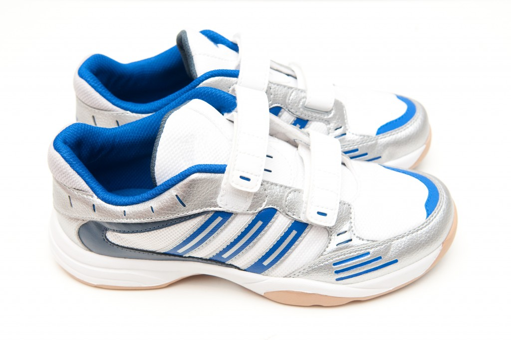 Training shoes with hook and loop fasteners.