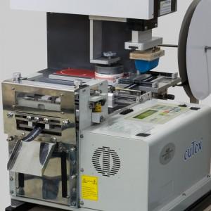 An industrial logo imprinting machine.