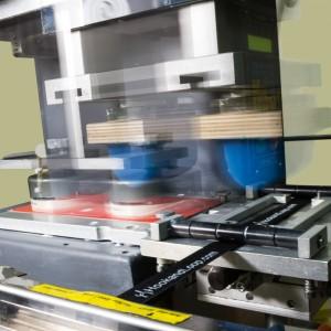 Pad printer in motion.