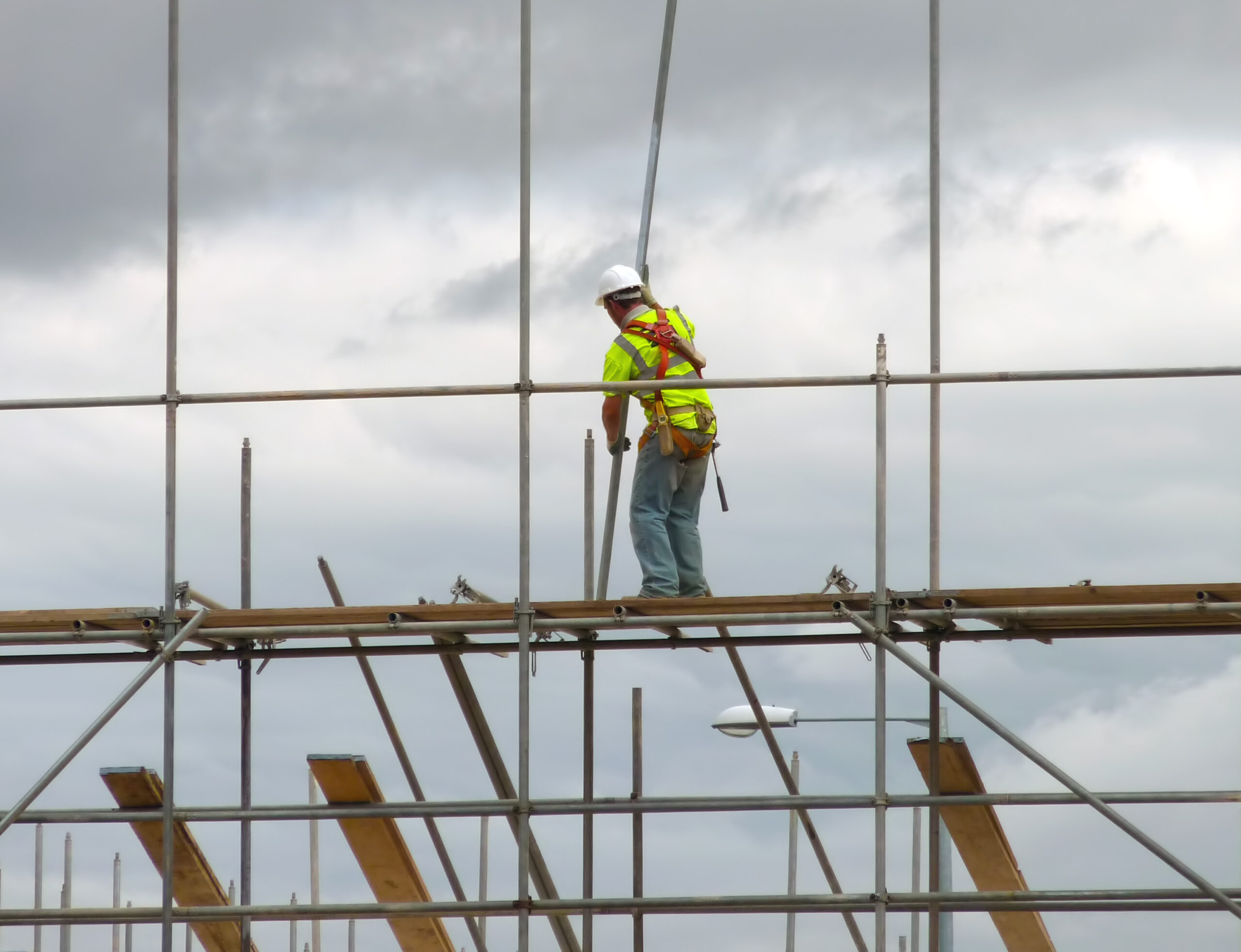 Man on scaffolding with velcro safety harness